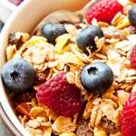 Muesli Bowl for Breakfast with Blueberries and Raspberries
